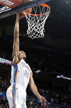 Photo - Oklahoma City's Thabo Sefolosha (25) shoots a lay up during the NBA game between the Oklahoma City Thunder and the Minnesota Timberwolves at the Chesapeake Energy Arena, Sunday, Dec. 1, 2013. Photo by Sarah Phipps, The Oklahoman