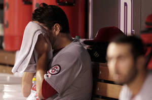 Photo - St. Louis Cardinals starting pitcher Lance Lynn wipe his face in the dugout after the fifth inning of a baseball game against the Colorado Rockies in Denver on Monday, Setp. 16, 2013.(AP Photo/Joe Mahoney)