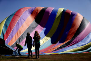 Photo - University of Central Oklahoma students with the Student Programming Board help inflate a hot air balloon before offering rides to students and faculty.