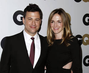 "Photo -   FILE - This Nov. 17, 2011 file photo shows late night talk show host Jimmy Kimmel, left, and Molly McNearney arrive at the 16th annual GQ ""Men of the Year"" party in Los Angeles. Kimmel and McNearney are newly engaged. His spokesman, Lewis Kay, said Wednesday, Aug. 15, 2012, that Kimmel popped the question during a recent vacation in South Africa's Kruger National Park. McNearney is the co-head writer for the network's ""Jimmy Kimmel Live."" They started dating in 2009, after Kimmel's breakup with comic Sarah Silverman. (AP Photo/Matt Sayles)"