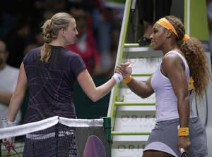 Photo - Petra Kvitova of Czech Republic, left, and Serena Williams of the USA clasp hands after their tennis match at the WTA championship in Istanbul, Turkey, Thursday, Oct. 24, 2013. The world's top female tennis players compete in the championships which runs from Oct. 22 until Oct. 27.(AP Photo)