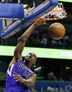 photo - Sacramento Kings' Tyreke Evans (13) dunks on a fast break against the Orlando Magic during the first half of an NBA basketball game, Wednesday, Feb. 27, 2013, in Orlando, Fla. (AP Photo/John Raoux)