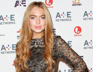 "Photo -   In this May 9, 2012 photo shows actress Lindsay Lohan at the A&E Networks 2012 Upfront at Lincoln Center in New York. Lohan will star as Elizabeth Taylor in the upcoming Lifetime TV movie ""Liz & Dick."" On Friday June 15, Lohan's publicist Steve Honig said the actress was treated for dehydration and exhaustion after an overnight film shoot, but did not require a trip to the hospital and would likely resume shooting later Friday. (AP Photo/Starpix, Kristina Bumphrey, file)"