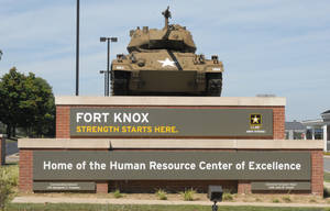 Photo - This Aug. 18, 2010 image provided by the U.S. Army shows the Chaffee Gate entrance to Fort Knox. An Army civilian employee was shot and killed in a parking lot at Kentucky's Fort Knox on Wednesday, and investigators were seeking to question a man in connection with the shooting, authorities said. Army officials said in a news release late Wednesday April 3, 2013 that the victim was an employee of the U.S. Army Human Resources Command, which handles personnel actions for soldiers. The shooting occurred in a lot outside the command. The victim was transported to the Ireland Army Community Hospital where he was pronounced dead. (AP Photo/US Army)