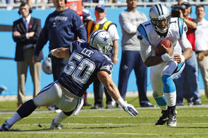 Photo -   Carolina Panthers quarterback Cam Newton (1) runs as Dallas Cowboys inside linebacker Sean Lee (50) defends during the first half of an NFL football game on Sunday, Oct. 21, 2012, in Charlotte, N.C. (AP Photo/Chuck Burton)