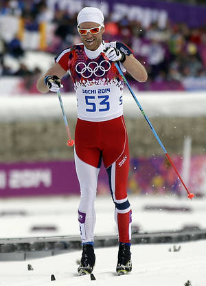 Photo - Norway's Martin Johnsrud Sundby competes with his sleeves cut, during the men's 15K classical-style cross-country race at the 2014 Winter Olympics, Friday, Feb. 14, 2014, in Krasnaya Polyana, Russia. (AP Photo/Gregorio Borgia)