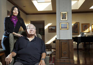 Photo - N. Scott Momaday poses recently with his daughter, Jill Momaday, at Oklahoma City University's Wilson House in Oklahoma City.  Photo by  Sarah Phipps, The Oklahoman