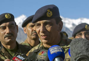 Photo -   FILE - In this April 18, 2012 file photo, Pakistan's army chief Gen. Ashfaq Parvez Kayani talks with reporters after visiting a Siachen area at Skardu, Pakistan. The top U.S. commander in Afghanistan held talks with Pakistan's army chief Saturday aimed at improving border coordination, almost six months after American airstrikes accidentally killed 24 Pakistani soldiers along the frontier. (AP Photo/B.K. Bangash, File)