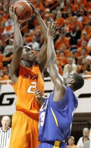 Photo - OSU's  Ibrahima  Thomas shoots the ball over Joe Richard of Tulsa during the college basketball game between Oklahoma State University Cowboys and the University of Tulsa in Stillwater, Okla., Thursday, Nov. 20, 2008. BY BRYAN TERRY
