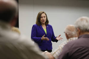 Photo - In this photo from April 29, 2013, Sen. Deb Fischer, R-Neb., gestures during a town meeting in Nebraska City, Neb., Monday, April 29, 2013. Fischer's opposition to a pathway to citizenship for people in the country illegally resounds loudly with her rural Nebraska constituents, yet clashes with calls from Republicans elsewhere for compromise. (AP Photo/Nati Harnik)