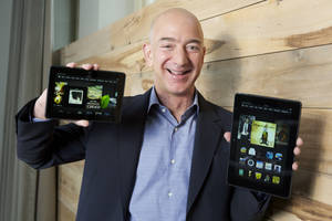 "Photo - IMAGE DISTRIBUTED FOR AMAZON – In this image distributed on Tuesday, Sept. 24, 2013, Amazon.com Founder and CEO Jeff Bezos introduces the all-new Kindle Fire HDX 8.9'', right, and Kindle Fire HDX 7'' tablet in Seattle."" ORG XMIT: INVL"