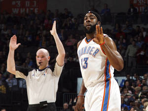 Photo - Oklahoma City's James Harden celebrates a 3-pointer during the NBA game between the Oklahoma City Thunder and the Houston Rockets, Wednesday, March 24, 2009, at the Ford Center in Oklahoma City. Photo by Sarah Phipps, The Oklahoman