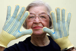 Photo - FILE - Stephanie Kwolek, 83, shown in this June 20, 2007 file photo taken in Brandywine Hundred, Del.,  she wears regular house gloves made with the Kevlar she invented. Her friend, Rita Vasta, told The Associated Press that Stephanie Kwolek died Wednesday in a Wilmington hospital. at age 90. (AP Photo/The News Journal, Jennifer Corbett)