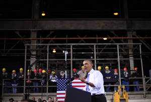 Photo - FILE - In this Nov. 14, 2013, file photo, President Barack Obama speaks at ArcelorMittal, a steel mill in Cleveland. The Commerce Department releases final third-quarter gross domestic product on Friday, Dec. 20, 2013. (AP Photo/Pablo Martinez Monsivais, File)