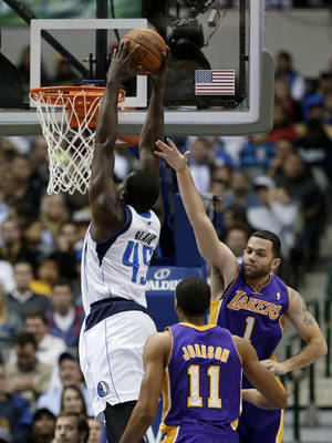Photo - Dallas Mavericks' DeJuan Blair (45) gets by Los Angeles Lakers' Wesley Johnson (11) and Jordan Farmar (1) for a dunk in the first half of an NBA basketball game, Tuesday, Nov. 5, 2013, in Dallas. (AP Photo/Tony Gutierrez)