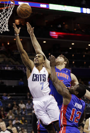 Photo - Charlotte Bobcats' Ramon Sessions (7) drives past Detroit Pistons' Will Bynum (12) and Viacheslav Kravtsov (55) during the first half of an NBA basketball game in Charlotte, N.C., Wednesday, Feb. 20, 2013. (AP Photo/Chuck Burton)