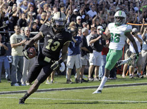 Photo -   Purdue wide receiver Antavian Edison (13) scores on a 41-yard pass in front of Marshall defensive back Monterius Lovett during the first half of an NCAA college football game in West Lafayette, Ind., Saturday, Sept. 29, 2012. (AP Photo/Michael Conroy)