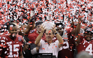 Photo - Alabama head coach Nick Saban celebrates with his team after the BCS National Championship college football game against LSU Monday, Jan. 9, 2012, in New Orleans. Alabama won 21-0. (AP Photo/Gerald Herbert) ORG XMIT: BCS192