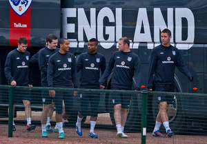 Photo -   England's Ashley Cole, 3rd right, shares a joke with Theo Walcott, 4th left, during a team training session, London Colney, Thursday Oct. 11, 2012. England will play against San Marino in a World Cup qualifying soccer match on Friday. (AP Photo/Tom Hevezi)