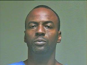Photo - Keenan Lamar Wooden, 47, was being held at the Oklahoma County jail on a $4,000 bail Tuesday for posessing a firearm as a felon. Wooden was held at gunpoint and shot multiple times in the early hours of Tuesday morning. <strong></strong>
