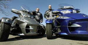 photo - Don, left, and Daniel Baker, father and son, ride their three wheelers down a street in Edmond, OK, Friday, February 22, 2013, By Paul Hellstern, The Oklahoman