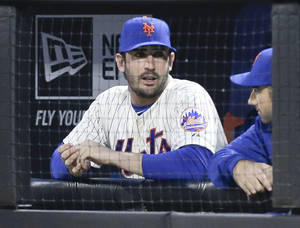 Photo - New York Mets starting pitcher Matt Harvey talks to a teammate before a baseball game against the St. Louis Cardinals Tuesday, April 22, 2014, in New York. The picture Harvey tweeted of himself making an obscene gesture on his way into surgery caused such a stir that the injured New York Mets ace has shut down his Twitter account. (AP Photo/Frank Franklin II)