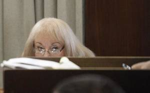 Photo - Former Sen. Debbe Leftwich watches legal arguments during her preliminary hearing Friday. <strong>The Oklahoman - Steve Gooch</strong>