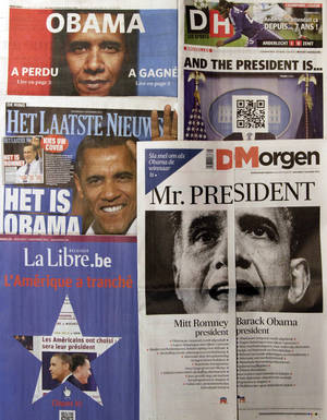 "Photo -   A spread of Belgian newspapers is shown in Brussels on the morning after the U.S. elections, Wednesday, Nov. 7, 2012. Faced with U.S. election results coming after printing deadlines, Belgian newspapers found novel ways around the problem. Het Laatste Nieuws, middle left, produced two front pages, asking readers to ""pick your cover."" One was headlined ""It's Obama"" while another, folded inside, read ""It's Romney."" De Morgen, bottom right, cut its front page in half, with one side saying ""Mitt Romney President"" and the other ""Barack Obama President."" On the Romney side it said ""Please turn quickly if Obama is the winner."" Le Soir's front page, top left, screamed ""Obama,"" followed on the left with ""Has Lost ,read page 2"" and on the right ""Has Won, read page 3."" Sports newspaper La Derniere Heure, top right, left the face blank and instead provided a scan code to download the winner onto a cellphone. (AP Photo/Virginia Mayo)"