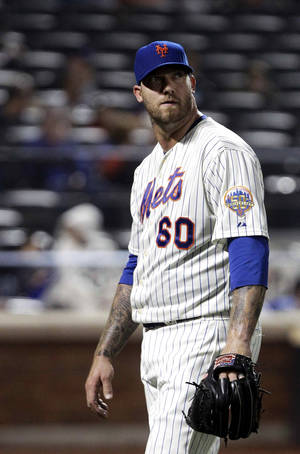 photo -   New York Mets relief pitcher Jon Rauch (60) leaves the field in the middle of the eighth inning of a baseball game against the Arizona Diamondbacks, Friday, May 4, 2012, in New York. (AP Photo/Frank Franklin II)