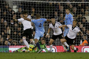 Photo - Manchester City's Vincent Kompany, 4, scores during the English Premier League soccer match between Fulham and Manchester City at Craven Cottage stadium in London, Saturday, Dec. 21, 2013.  (AP Photo/Matt Dunham)