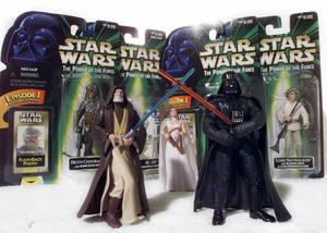 "photo -   FILE - ""Star Wars"" action figures Darth Vader, right, and Ben (Obi-Wan) Kenobi, left, are displayed in this April 7, 1999 file photo, with Princess Leia Organa in her ceremonial dress in front of other packaged characters from the new film. The National Toy Hall of Fame announces its class of 2012 Thursday Nov. 15, 2012. Two toys will be inducted into the Rochester hall from among 12 nominees. (AP Photo/ Victoria Arocho, File)"