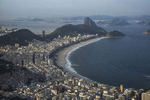 Photo - This aerial photo shot through an airplane window shows a view of the Copacabana beach and neighborhood, in Rio de Janeiro, Brazil, Tuesday, May 13, 2014. As opening day for the World Cup approaches, people continue to stage protests, some about the billions of dollars spent on the World Cup at a time of social hardship, but soccer is still a unifying force. The international soccer tournament will be the first in the South American nation since 1950. (AP Photo/Felipe Dana)