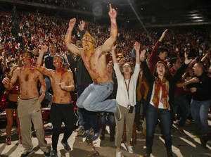 Photo - Florida State fans react as they watch a touchdown in the final seconds of the BCS Championship football game between Florida State and Auburn on a 30-foot screen at the Tallahassee Leon County Civic Center on Monday, Jan. 6, 2014, in Tallahassee, Fla. Florida State beat Auburn 34-31. (AP Photo/Phil Sears)