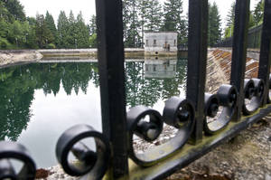 Photo - The Mount Tabor number 1 reservoir in Portland, Ore., is seen in a June 20, 2011 photo.  Portland officials said Wednesday, April 16, 2014 that they are flushing away millions of gallons of treated water for the second time in less than three years because someone urinated into a city reservoir. In June 2011, the city drained a 7.5 million-gallon reservoir at Mount Tabor in southeast Portland. This time, 38 million gallons from a different reservoir at the same location will be discarded after a 19-year-old was videotaped in the act  (AP Photo/The Oregonian, Benjamin Brink)