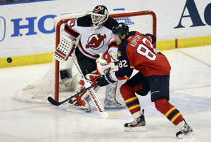 Photo -   New Jersey Devils' goalie Martin Brodeur (30) and Florida Panthers' Tomas Kopecky (82) wait for a puck during the third period of Game 7 in a first-round NHL Stanley Cup playoff hockey series in Sunrise, Fla., Thursday, April 26, 2012. The Devils won 3-2. (AP Photo/J Pat Carter)