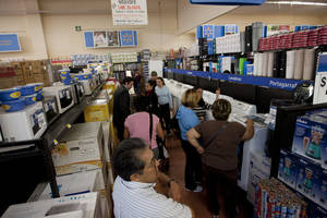 Photo - In this Nov. 18, 2011 photo, people shop at a Wal-Mart Superstore in Mexico City. Wal-Mart Stores Inc. hushed up a vast bribery campaign that top executives of its Mexican subsidiary carried out to build stores across Mexico, according to a published report by the New York Times. (AP Photo) ORG XMIT: MXDL102