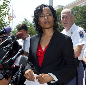 Photo -   Prince George's County, Md. State Attorney Angela Alsobrooks, left, accompanied by Police Chief Mark Magaw, listens to reporters questions during a news conference at the Prince George's County Courthouse in Upper Marlboro, Md., to provide an update on the status of criminal charges against Neil Prescott Wednesday, Aug. 1, 2012. Prescott was found last week with multiple firearms and thousands of rounds of ammunition. (AP Photo/Manuel Balce Ceneta)