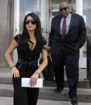 "Photo -   Rima Fakih, left, and defense attorney W. Otis Culpepper leave District Court in Highland Park, Mich., on Wednesday, May 9, 2012. Fakih, the first Arab-American to be crowned Miss USA, avoided jail during sentencing Wednesday in a drunken driving case, an experience she called ""very humbling."" (AP Photo/The Detroit News, David Coates)"