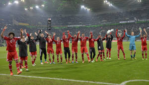 Photo - The Bayern team celebrate after winning the German Bundesliga soccer match between Borussia Moenchengladbach and Bayern Munich in Moenchengladbach, Germany, Friday, Jan. 24, 2014. Bayern defeated Moenchengladbach with 2-0. (AP Photo/Martin Meissner)