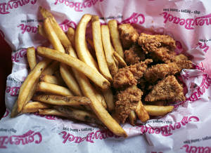 Photo - FILE PHOTO: A plate of Rex's chicken and fries at Coney Beach, which was converted to Rex's Chicken. <strong>ARAM BOGHOSIAN - TULSA WORLD</strong>