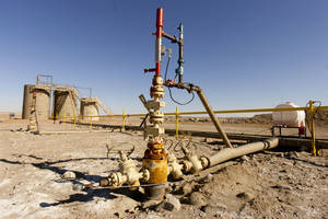 Photo -   Equipment in the oil fields of the Uintah Basin, southeast of Vernal, Utah is seen.  AP File Photo  <strong>Trent Nelson -  AP </strong>