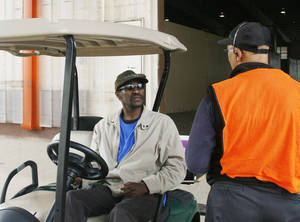 photo - Tony Alexander talks to a fellow employee outside of the animal barns at the Oklahoma State Fair on Sunday, Sept. 16, 2012. It's the fifth year Alexander has come to work to clean the faigrounds. Photo by Julianna Keeping, The Oklahoman