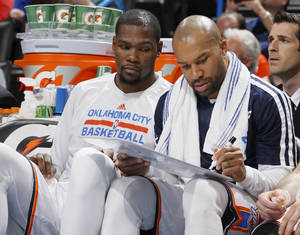 Photo - Oklahoma City's Kevin Durant and Derek Fisher talk on the bench during an NBA basketball game between the Oklahoma City Thunder and the New Orleans Pelicans at Chesapeake Energy Arena in Oklahoma City, Friday, April 11, 2014. Oklahoma City won 116-94. Photo by Bryan Terry, The Oklahoman