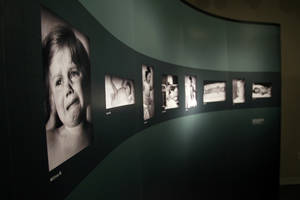 "Photo -   In this July 24, 2012 photo, images of children who were part of medical experiments led by the Nazis are on display at the National World War II Museum in New Orleans. The traveling U.S. Holocaust Memorial Museum exhibit ""Deadly Medicine: Creating the Master Race"" will be at the New Orleans museum through mid-October. Tulane University plans a series of related lectures. (AP Photo/The Times-Picayune, Chris Granger) MAGS OUT; NO SALES; USA TODAY OUT"