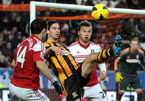 Photo - Hull City's George Boyd, centre, battles for the ball with Fulham's Giorgos Karagounis, left,  and Elsad Zverotic during their English  Premier League match at the KC Stadium, Hull England Saturday Dec. 28, 2013.(AP Photo/Anna Gowthorpe/PA) UNITED KINGDOM OUT