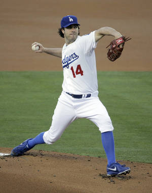 Photo - Los Angeles Dodgers starting pitcher Dan Haren throws to the Cleveland Indians during the first inning of a baseball game in Los Angeles, Monday, June 30, 2014. (AP Photo/Chris Carlson)
