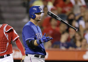 Photo - Texas Rangers' A.J. Pierzynski tosses his bat after swinging and missing on a pitch during the eighth inning of a baseball game against the Los Angeles Angels on Friday, Sept. 6, 2013, in Anaheim, Calif. (AP Photo/Jae C. Hong)