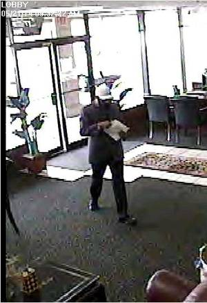 Photo - A man who revealed a pistol tucked in his waistband robbed the First Fidelity Bank, 10904 N May Ave. in northwest Oklahoma City, about 9:45 a.m. Wednesday. <cutline_credit_leadin>Photo provided</cutline_credit_leadin> <strong></strong>