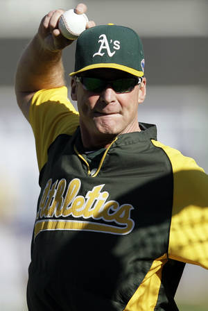 Photo -   Oakland Athletics manager Bob Melvin throws batting practice before Game 3 of an American League division baseball series against the Detroit Tigers in Oakland, Calif., Tuesday, Oct. 9, 2012. (AP Photo/Eric Risberg)