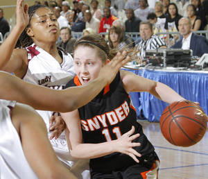 Photo - Snyder's Marley Anderson (11) drives to the basket during the semi final 2A girls State Basketball Championship game between Snyder High School and Northeast High School at the State Fair Arena on Friday, March 9, 2012 in Oklahoma City, Okla.  Photo by Chris Landsberger, The Oklahoman